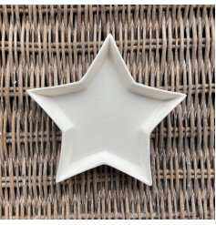 A small ceramic star shaped trinket dish, perfect for placing in any home space needing to keep trinkets safe