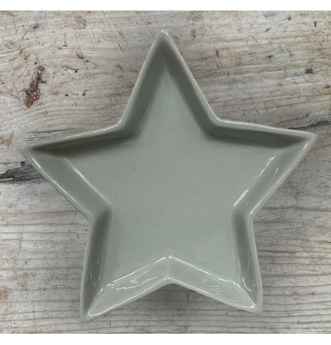 A small and simple star shaped ceramic dish, suitable for trinkets and decor in your home