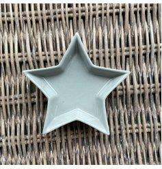 A ceramic star shaped dish featuring a smooth grey glaze finish