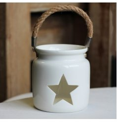 A small T-light holder set with a sleek white tone and star cut window to finish