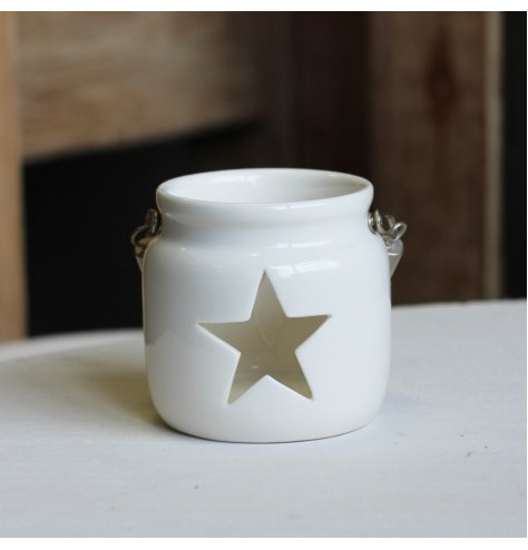 A Small T-light Holder in White with Star Cute out and Hanging Rope