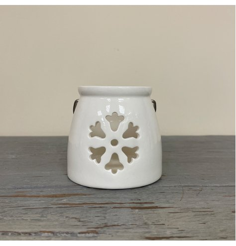 A Small tlight holder with a snowflake cut decal