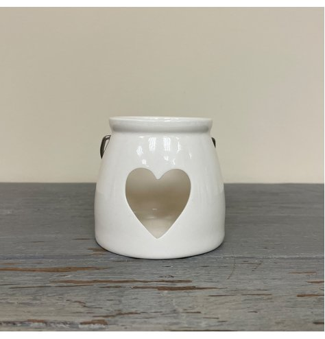 A Small tlight holder with a heart cut decal