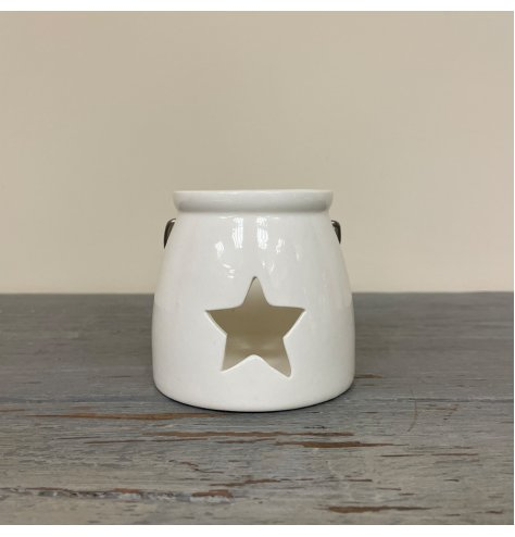 A Small tlight holder with a star cut decal