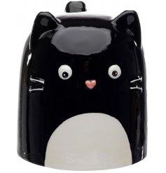 A ceramic mug with a Feline Fine Decal to it