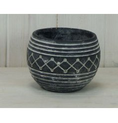 A rounded bowl shaped planter featuring an overly distressed black tone and aztec inspired decal to finish
