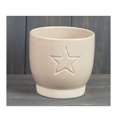 Chic and Simple, a small ceramic pot in a smooth cream colour, complete with an embossed star decal