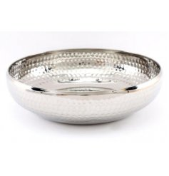 A large decorative metal bowl featuring a silver tone and hammered finish