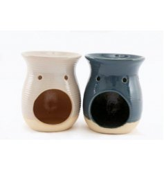 An assortment of cream and blue toned ribbed oil burners, perfect for bringing a coastal feel to any home space