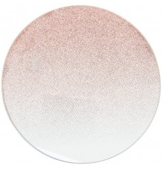 A round mirrored candle plate featuring an ombre glitter rose gold decal to it