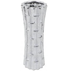 an ornamental vase with a bamboo inspired decal to it