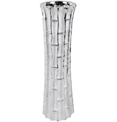 Surrounded with a bamboo inspired decal, this tall decorative vase also features a luxe silver toned finish