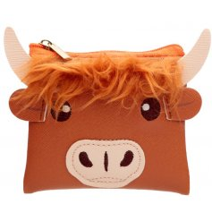A quirky orange highland cow purse with added faux fur trimmings