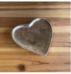 An overly distressed silver heart plate, a perfect little ornament to add to your home