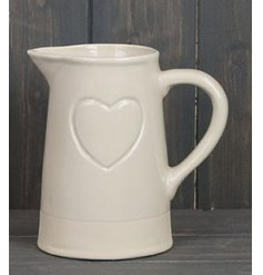 Sure to add a simple charm to your surrounding home space, a cream toned decorative jug with embossed heart decal