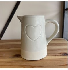 Sure to add a simple charm to your surrounding home space, a smooth toned decorative jug with embossed heart decal