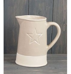 A chic and simple 2 toned jug featuring an embossed star decal to its centre