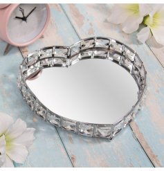 Perfect for bringing a sparkly luxe feel to your home, a heart shaped tray with added crystals