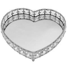 A gorgeously glitzy heart shaped tray with a mirrored centre and acrylic crystals surrounding it