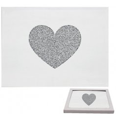 A gorgeously decorated set of Mirrored Placemats, each designed with a stunning crystal heart centre