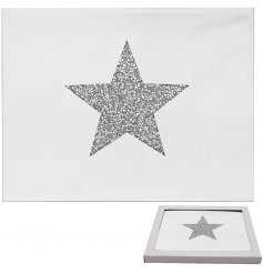 A set of rectangular shaped mirrored placemats, each decorated with a glittery star centred design