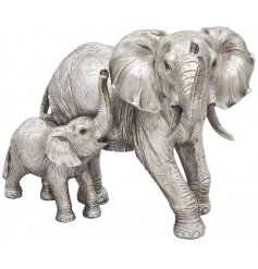 A beautifully posed elephant and baby calf ornament in a luxe silver tone