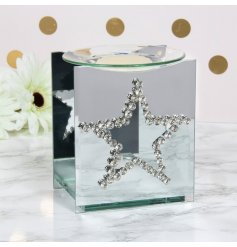 A gorgeous and glitzy themed glass oil burner set with a mirrored backing and cut star window
