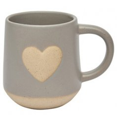 A grey toned ceramic mug featuring a stoneware inspired heart central decal