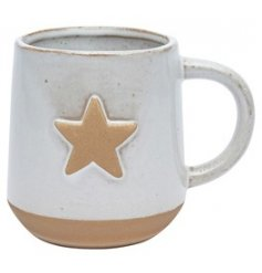A chunky ceramic mug with a smooth off white tone and embossed star centre