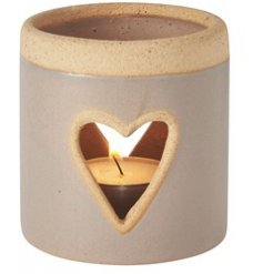A chic and simple themed T-light holder set with a smooth grey ceramic surround and heart cut window