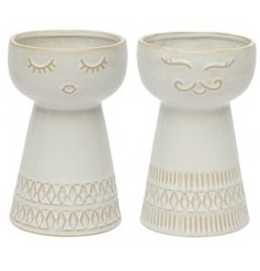 Assorted by their facial accents, these tall decorative vases are a must have for any Neutral themed home space