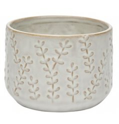 A charmingly simple ceramic planter in a off-white glazed tone