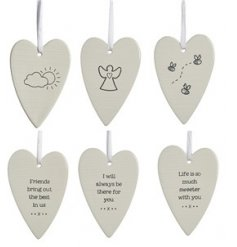 An assortment of charmingly chic and simple hanging ceramic decorations with double sided prints to each