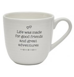 """""""Life was made for good friends and great adventures"""" scripted text mug in a sleek white tone"""