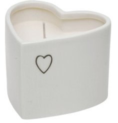 A sweetly scented wax candle in a charmingly simple white ceramic heart pot