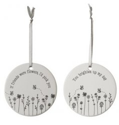 An assortment of hanging ceramic decorations, each with its own cute busy bee motif and text