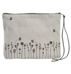 Decorated with a charming Busy Bee inspired design, this fabric makeup bag is sure to come in handy when travelling
