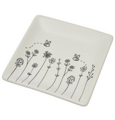 Decorated with a delightful Busy Bee print, this small white ceramic tray is a perfect accessory to bring to any home