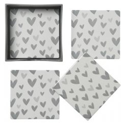 A charmingly simple set of square ceramic coasters, each decorated with a grey heart motif finish
