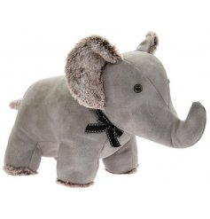 A Standing Elephant Doorstop set with a soft grey faux leather tone and finished with added faux fur trimmings