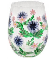 Covered with a beautiful hand painted Cornflower illustration, a stemless glass that comes with a matching gift box