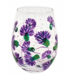 A sleek stemless glass covered with a beautiful hand painted Purple Thistle illustration