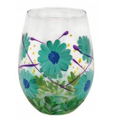 Set with beautiful colours and detailing, this stemless glass features a striking hand painted Blue Gerbera design aroun