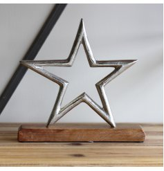 A natural wood block based ornament with a textured metal star to feature