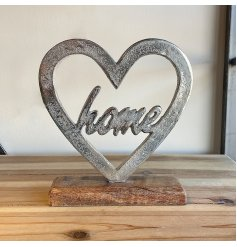 A chic and simple decorative metal heart set upon a wood base