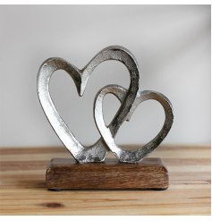 A natural wood block based ornament featuring a rough finished linked heart