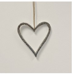 A chic silver metal heart decoration. Beautifully detailed with a hammered finish and complete with a jute string hanger