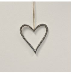 A stylish and unique silver hanging heart decoration. Complete with a textured surface and jute hanger.