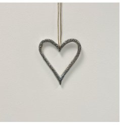A chic silver metal hanging heart decoration, complete with a rustic jute string hanger.