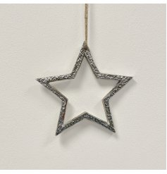 A stylish silver metal star decoration. A chunky item with plenty of character and charm.